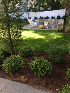 Carey Ezell Landscape Design, LLC. Fire bowl patio, field stone wall, blue stone patio