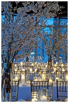 Use candles to light up your venue with white blossomed branches / http://www.deerpearlflowers.com/twigs-and-branches-wedding-ideas/
