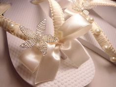 Ivory bridal flip flops embellished in macrame and beaded starfish by Adriana Dos Santos