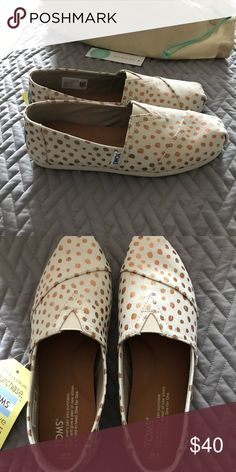 9eb9fd08a64 Shop Women s Toms Gold Tan size 6 Flats   Loafers at a discounted price at  Poshmark. Description  Brand new gold and tan Toms