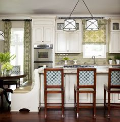 love the kitchen drapes, church pew as a sitting area, cabinets and fabrics!