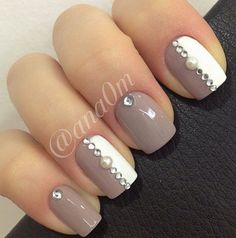 Chocolate and white colored winter nail art design. Give some spice to a rather plain looking design by adding pearls and silver beads on top for accent.