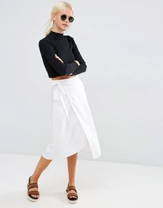 White linen skirt and black I'll neck - unconventional as it mixes summer and winter items but still looks put together (transitional wear?)