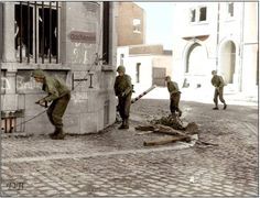 Soldiers of 'B' Company, 16th Infantry Regiment, US 1st Infantry Division, advancing through Battice in Belgium, en route to Aachen, 10th September 1944.