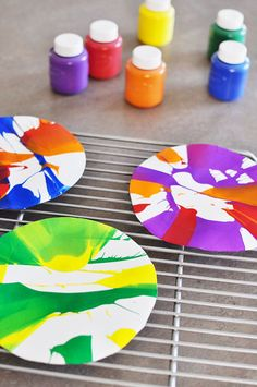 rainy day activity:  all you need are paints, paper plates, and a salad spinner!