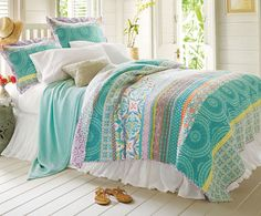 """Positano Bedding Collection In 1953, John Steinbeck wrote, """"Positano is dream place that isn't quite real when you are there and becomes beckoningly real after you have gone."""" Inspired by the dramatic splendor of this town on Italy's Amalfi coast, our Positano quilt is an exotic mix of color and pattern. Banded with an assortment of tile motifs from Spain, Morocco, Portugal and Italy, it's rendered in brilliant shades of the season: aqua, celadon, lilac and coral, reversing to a scrolling…"""