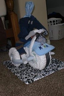 Tricycle diaper cake for baby shower.