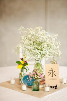 How to have fun with your centerpieces wedding. Captured By: Luke and Cat Photography #weddingchicks http://www.weddingchicks.com/2014/07/11/have-some-fun-with-your-table-numbers/