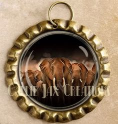 Bronze Bottle Cap Pendant with Original Artwork. Elephant herds. Great for purse charms, day planner charms, keychain charms and zipper pulls.