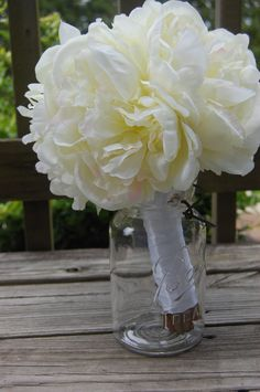 Keep a jar at the head table to put your bridal bouquet in.