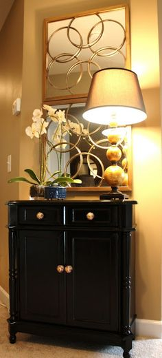 Hint of Oriental style. A painted eBay cabinet with new hardware could achieve this.