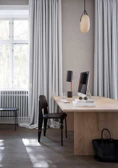 Simple workspace | Contemporary wooden desk, black wood chair, grey full-length cutrains | @styleminimalism