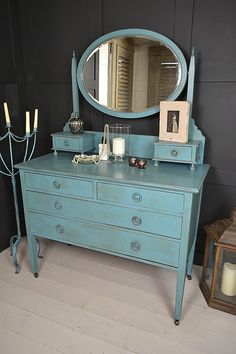 This vibrant vintage dressing table has 6 drawers and large moveable mirror. We've painted the inner drawers in Annie Sloan Duck Egg Blue and aged with dark wax. Why not brighten your mornings and get ready in style!