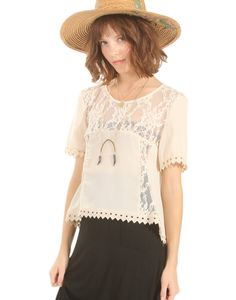A sweet and dainty chiffon and lace mix top with a cute diamond trim around the sleeves and hem. Finish off the look with a black maxi skirt and a straw hat.