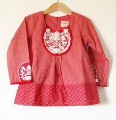 White Lotus embroidered design baby girl smock dress. size 6