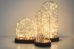 A beautiful table light that merges the vintage aesthetic of a glass dome with modern, energy-efficient LED lighting to produce a statement piece for any room. Glass Bell Jar, The Bell Jar, Glass Vessel, Glass Domes, Starry String Lights, Unique Table Lamps, Visual Display, Fireplace Mantle, Light Table