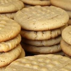 My husband loves all of my cookie recipes, but this one is his all time favorite!! Very rich, and full of peanut butter flavor. When I bake these, the cookie jar empties out really fast!