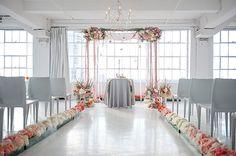 Romantic Modern Wedding Ceremony - love the flowers lining the aisle!