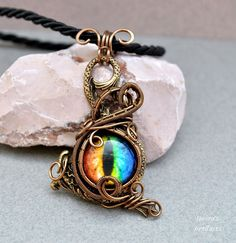 Multicolour Dragon's eye on a sea monster wire wrapped pendant - OOAK by Ianira on Etsy