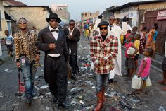 National Geographic | Pascal Maitre - Kinshasa's young sapeurs parade the Matonge neighborhood