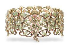 An Art Nouveau multi-gem and enamel 'glycines' tour-de-cou, by Philippe Wolfers