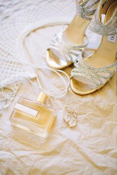Many a bride picks out a brand-new scent for her walk down the aisle, ensuring she'll always think back to her wedding when certain notes waft into her area. The bottles are typically gorgeous, too, making them a nice buddy to shoot with your shoes and jewelry. Love this bride's choice of Amour Liquide perfume!
