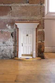 The Fairy Doors of Ann Arbor have been painstakingly cataloged by Jonathan B. Wright; check out his site for plenty more of these peculiar little entryways.