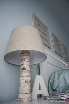 THIS IS AMAZING! Come learn to make your own DIY stacked wood lamp inspired by Anthropologie for only $40! Full tutorial by Designer Trapped in a Lawyer's Body.