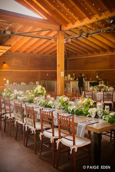 Add a lush garland to add texture and continuity throughout the long farm table #Newberrybros #Denver #Wedding