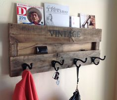 NEED! Creative coat rack for the small landing at the end of the stairs!