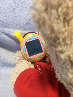 playing Tamagocchi
