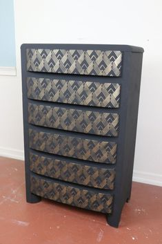 Our office craft guru scooped this old dresser up at a garage sale. This is how she gave it a stunning makeover