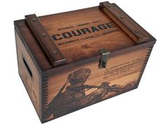 US Military Values Ammunition Box. This large ammo box features patriotic artwork of a US Military Veteran on the front and US Military Values Text on the top. Stores up to 500 shotgun shells.Handcrafted in the USA.WEIGHT – 14 lbsDIMENSIONS – Exterior : 16 x 10 x 10 Interior : 14 1/4 x 8 1/2 x 8 1/2Nameplates are placed on the front and center of Lid.Relic Wood LLC. will accept your exchange or return, if the item is in original condition and simply not what you want. There will be a 15% restock Military Box, Military Shadow Box, Military Gifts, Military Veterans, Playing Card Box, Mission Oak, Display Case, Keepsake Boxes, Wooden Boxes