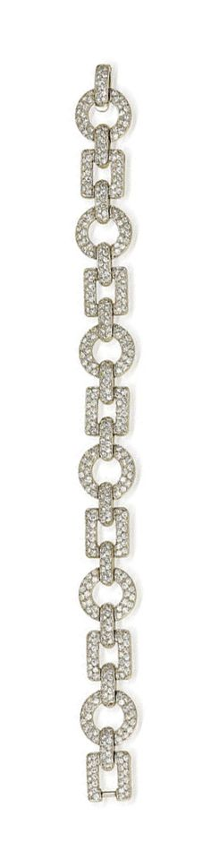 A diamond bracelet, Cartier  designed as alternating circular and square-shaped openwork links set throughout with single-cut diamonds; signed Cartier, no. 6140; estimated total diamond weight: 9.00 carats; mounted in platinum; length: 7in.