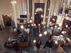 Light Installation at Merci, Paris via designboom: Love this array of industrial lamps. #Lighting #Merci #Paris