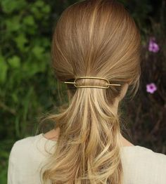 This minimalist hair barrette holds hairdos or ponytails securely in hammered brass.