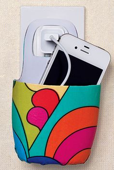 Plastic bottle cell phone holder photo by Lori Eanes