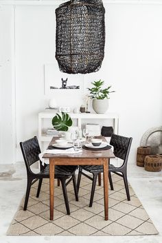This hooped fishnet fabric pendant lamp is gorgeous.
