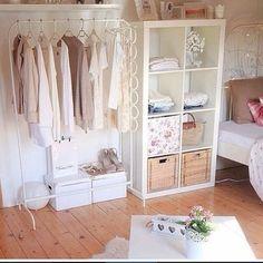 Rolling rack & upright storage shelf for extra closet storage. Can use baskets for flip flops, etc