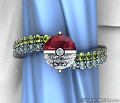 """The Pokèmon Engagement Ring What better way to get your biggest catch of all than with a Pokèmon themed engagement ring. That's right, the engagement ring, titled """"Trainer's Band"""", represents your true pokemon commitment. The green gems represent the health you have at the start of a battle, and the other row of Topaz stones shows your experience. No great ball or master ball can catch the women of your dreams better than the Pokemon engagement ring."""