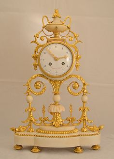 Prestigious, rare and elegant #clock signed #Chantrot in Paris in white #marble and #ormolu. Large white enamel dial-plate with red color signature. Decoration on top of a flower vase with handles and silver chain. White marble base. #LouisXVI, 18th century. For sale on Proantic by Clock Prestige.