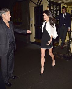 She worked a feminine two-toned minidress with simple accessories, from her drop earrings to her black pumps. She looked elegant and just a touch sexy for date night with George.