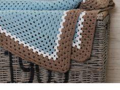 Het haken van een vierkanten deken