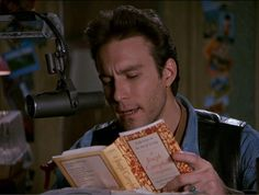 From the television show Northern exposure it is Chris in the morning (John Corbett) reading on his radio show KBHR. He is reading A Joseph Campell Companion: Reflections on the Art of Living by Joseph Cambell Northern Exposure Tv Show, Best Television Series, Tv Series, Book Club List, John Corbett, Celebrities Reading, Fictional Heroes, Nostalgia, What Book