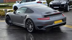 #Porsche 911 Turbo S sitting pretty outside the dealership after a matte grey wrap by #Reforma