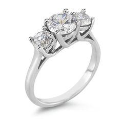 Classic three stone ring. I love the trellis work holding the diamonds.