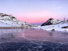 Rare black ice on Lago Bianco, St Moritz, Switzerland