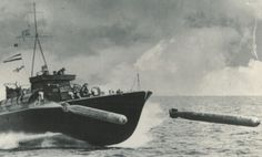 As yet unidentified Motor Torpedo Boat firing torpedos