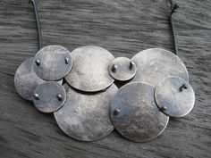Sterling silver artisan cloud necklace by LisaColbyMetalsmith on Etsy https://www.etsy.com/listing/129702443/sterling-silver-artisan-cloud-necklace