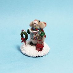 Handmade miniature Christmas mouse singing carols in the snow with tiny candy cane and wreath and mini salvation army bucket. Polymer Clay Animals, Miniature Christmas, Christmas Carol, Candy Cane, Dollhouse Miniatures, Singing, Bucket, Army, Teddy Bear
